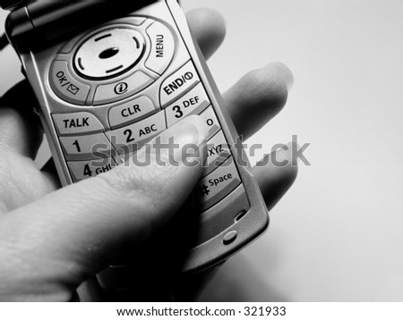 Woman holding cellular phone