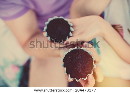 Woman holding chocolate cake in beautiful hands - stock photo