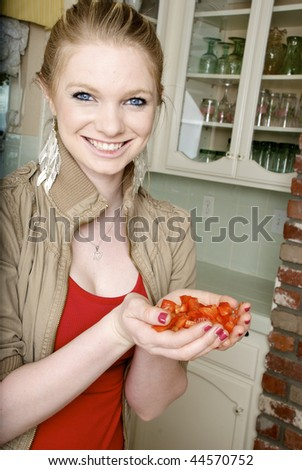 Woman Holding Chopped up Red Bell Peppers in her Hands