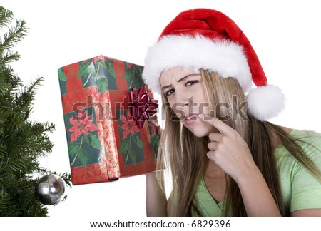 woman holding christmas gifts over white background