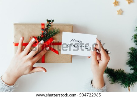 Woman holding Christmas gifts presents