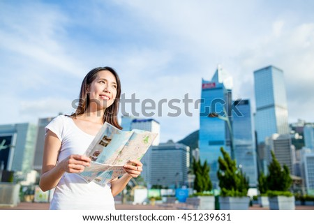 Woman holding city map  - stock photo