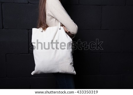Woman holding clean shopping bag