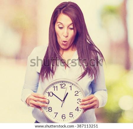 woman holding clock - stock photo