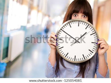 Woman Holding Clock, Indoor