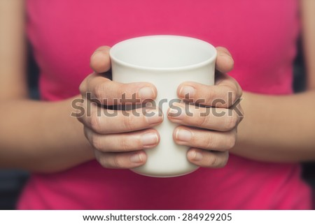 Woman Holding Coffe Cup - stock photo