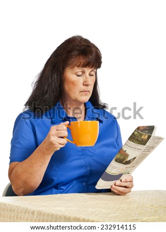 Woman Holding Coffee While Reading Paper - stock photo