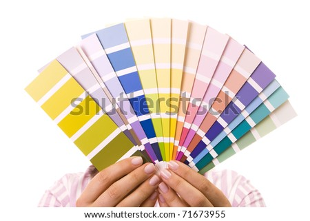 Woman holding color samples for selection - stock photo
