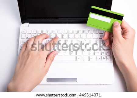 woman holding credit card and using laptop for online shopping - stock photo