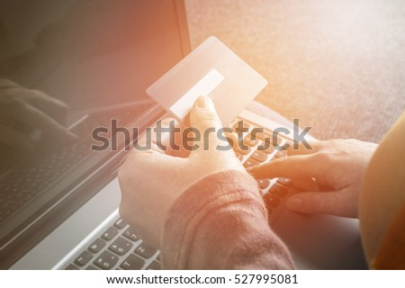 Woman holding credit card on laptop for online shopping concept. Selective focus