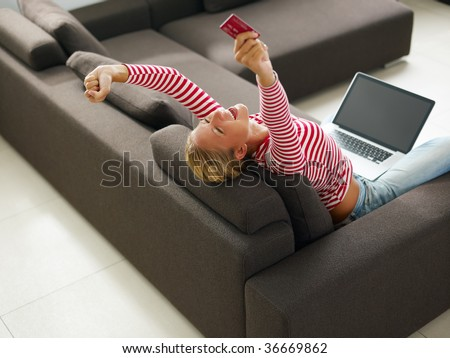 Woman holding credit card with arms raised. High angle view, Copy space - stock photo