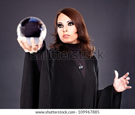 Woman holding crystal ball. Fortune telling. - stock photo