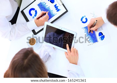 woman holding digital tablet, closeup - stock photo