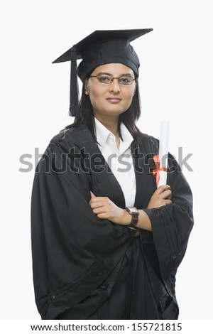 Woman holding diploma in graduation gown
