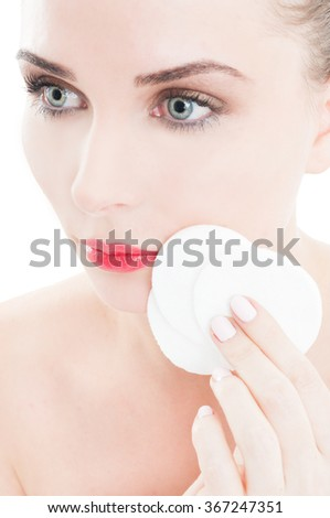 Woman holding face cleaner cotton disc as beauty concept