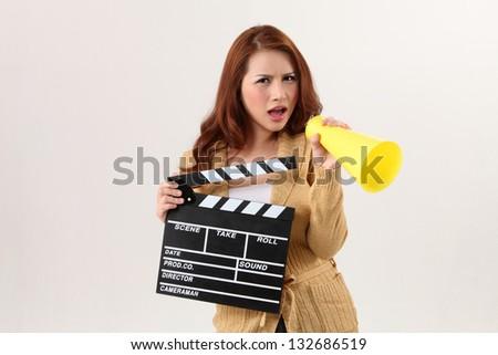 woman holding film slate and bullhorn - stock photo