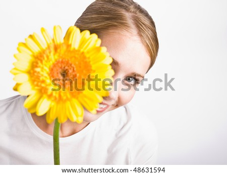 Woman holding flower - stock photo
