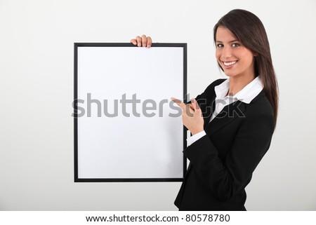 woman holding frame - stock photo