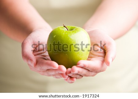 Woman holding fresh apple - stock photo