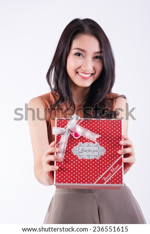 Woman holding gift box.