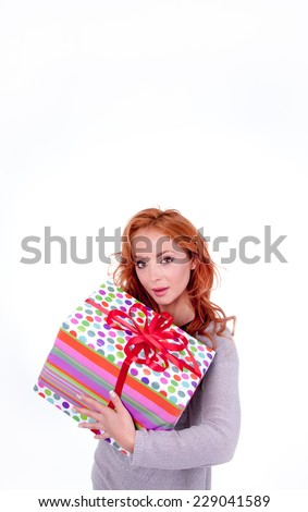 Woman holding gift box on white background