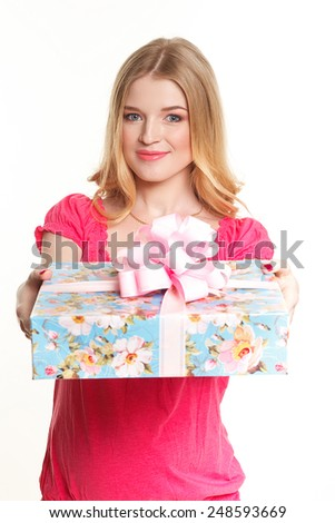 Woman holding gift box on white background - stock photo