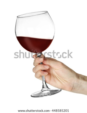 Woman holding glass of wine isolated on white