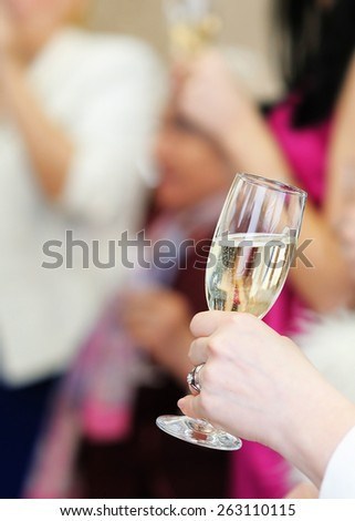 Woman holding glass with champagne  - stock photo