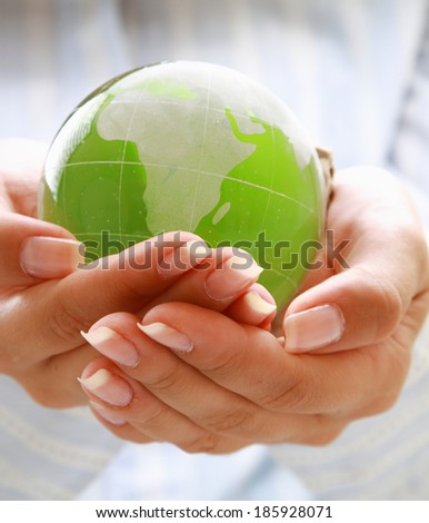 woman holding globe in her hand on white - stock photo