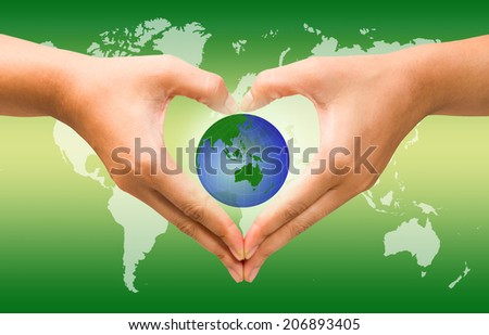 Woman holding globe on her hands over attractive background, Eco concept. - stock photo
