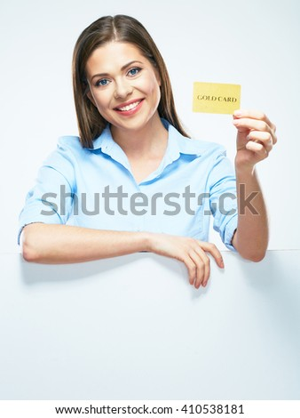 Woman holding gold  credit card. White blank sign board. Business woman smile - stock photo
