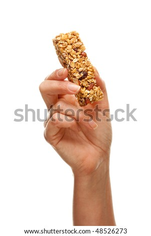 Woman Holding Granola Bar Isolated on a White Background. - stock photo