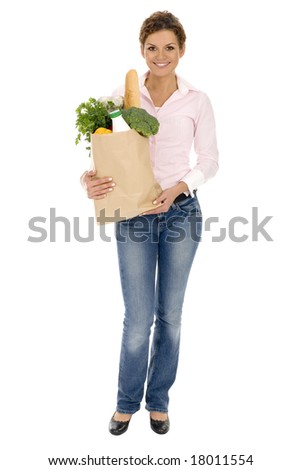 Woman holding grocery bag - stock photo