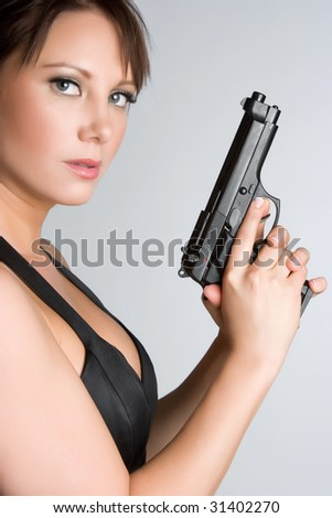 Woman Holding Gun - stock photo