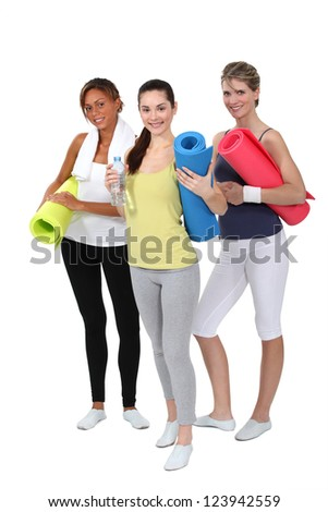 Woman holding gym mats - stock photo