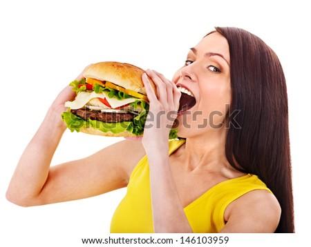 Woman holding hamburger. Isolated. - stock photo