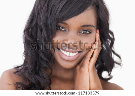 Woman holding hands to face against white background