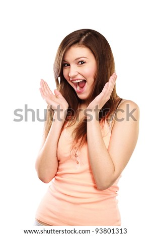 Woman holding hands to face in surprise - stock photo