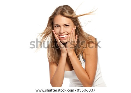 Woman holding hands to face in surprise over white background - stock photo