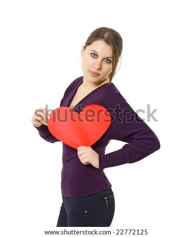 woman holding heart-shaped card for Valentines day - stock photo