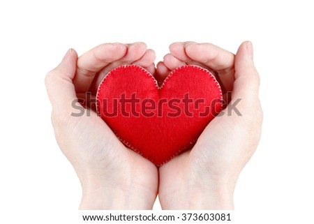 Woman holding heart symbol in hands. Concept of health, protection and love