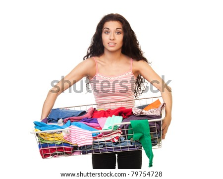 Woman holding heavy basket of clothes, isolated on white