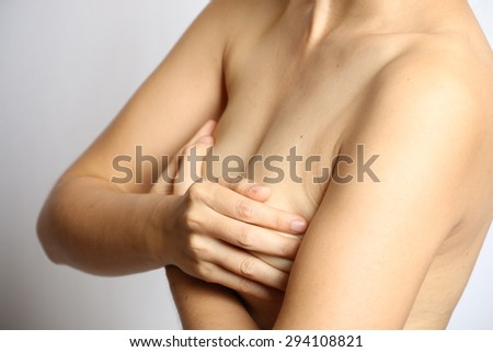Woman holding her breast - stock photo