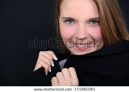 Woman holding her collar - stock photo