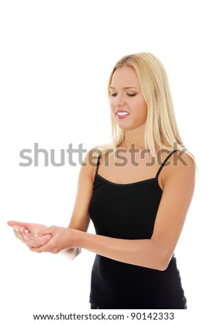 Woman holding her hand - pain concept - stock photo
