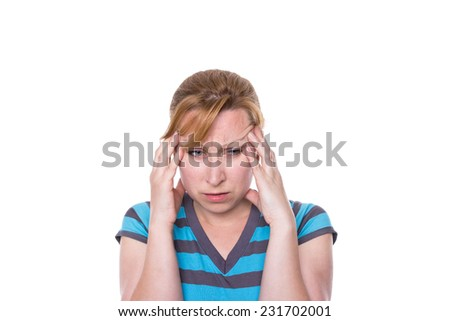 Woman holding her head with a severe headache