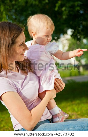 Woman holding her one year old daughter