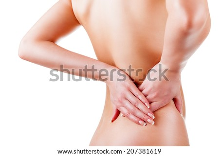 Woman holding her painful back isolated on white background