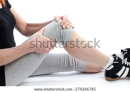 Woman holding her painful knee - stock photo