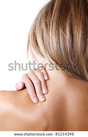 Woman holding her shoulder because of pain - stock photo